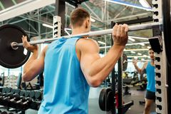 Strong Man Lifting Barbell in Gym royalty free stock photos