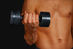 Strong man is lifting dumbbell Stock Photography