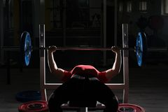 Heavy Powerlifter Weight Barbell Exercise Benchpress in Powerlif. Strong Man Lifting Heavy Barbell During Powerlifting Workout in Gym royalty free stock photo