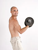 Strong man lifting weights for the biceps. Stock Photos