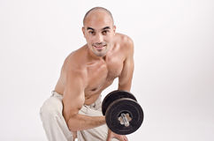 Strong man lifting weights for the biceps. Stock Photography
