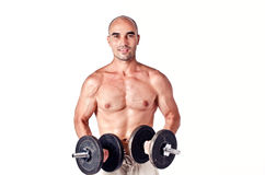 Strong man lifting weights. Stock Photo