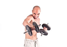Strong man lifting weights. Royalty Free Stock Photography