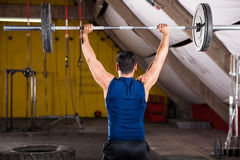 Strong man lifting weights Royalty Free Stock Photos