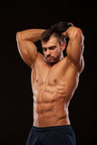Strong man making exercises on triceps with a dumbbell. Close up shot training hands. Fitness Model showing his Torso Royalty Free Stock Image
