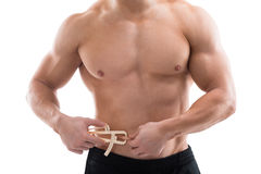 Strong Man Measuring Fats With Caliper. Midsection of strong man measuring fats with caliper against white background royalty free stock photography