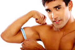Strong man measuring his biceps Royalty Free Stock Photography