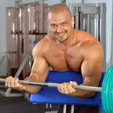 Strong man with naked torso exercising,  with barbell. Stock Image