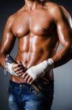 Strong man with nunchaku Royalty Free Stock Image
