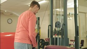 Man doing triceps exercises in the gym