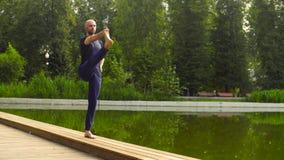 Strong man performing one-leg standing balance Royalty Free Stock Photo