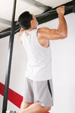 Strong man performing pull ups Royalty Free Stock Image
