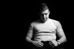 Strong man posing Stock Photography