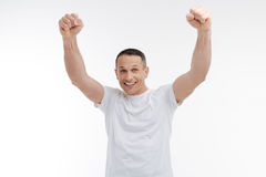 Strong man posing on camera Stock Images