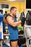 Strong man preparing his training machine Stock Photo