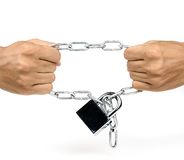Strong man. Pulling the chain with padlock Stock Photo