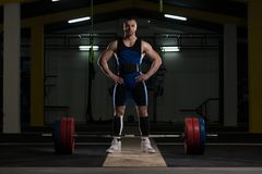Powerlifter Heavy Weight Barbell Exercise Deadlift in Powerlifti. Strong Man Ready to Lift Heavy Barbell From Floor During Powerlifting Workout in Gym royalty free stock images