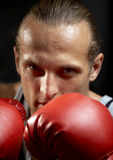 Strong man with red boxing gloves Royalty Free Stock Images