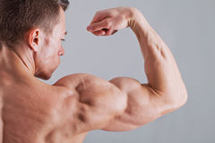 Strong man with relief body. Muscle arm of strong athlete Stock Photo