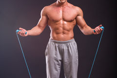 A strong man with a rope Stock Images