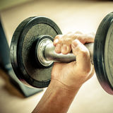 Strong man's hand takes a heavy dumbbell Royalty Free Stock Images