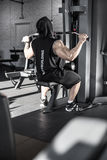 Strong man`s workout in gym Stock Image
