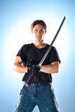 Strong man with samurai sword stock photos