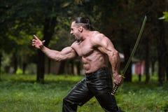 Strong Man With Samurai Sword Royalty Free Stock Image