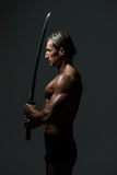 Strong Man With Samurai Sword Royalty Free Stock Images