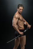 Strong Man With Samurai Sword Stock Images