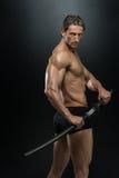 Strong Man With Samurai Sword Stock Images