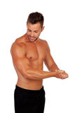 Strong man showing his muscles Stock Photo