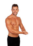 Strong man showing his muscles Royalty Free Stock Photos