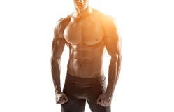 Strong man showing perfect abs, houlders, biceps, triceps and chest Stock Photo