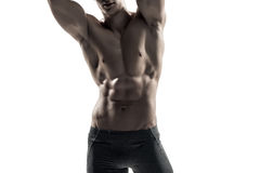 Strong man showing perfect body, abs and chest. Close-up Stock Photography