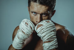 Strong man street fighter, by the hand wound rope. Royalty Free Stock Photos