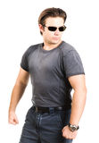Strong man in sunglasses Stock Images