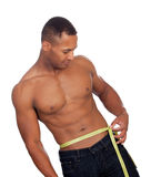 Strong man with tape measure Stock Images