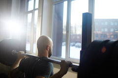 Strong Man Weightlifting in Gym stock photo