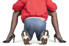 Strong man between woman's legs Royalty Free Stock Photography
