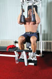 Strong  man work out in gym Stock Images