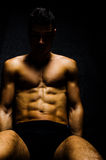 Strong man working abs Stock Images