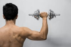 Strong man working out with dumbbell stock image