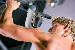 Strong man working out in gym Stock Image