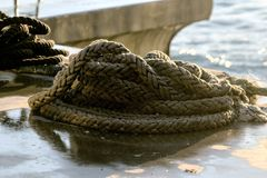 Strong marine rope lying on the ground with morning sun of Bosphorus on a winter day. stock photography