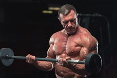 Strong mature bodybulding man in the gym royalty free stock photo