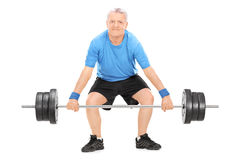 Strong mature man lifting a heavy weight Stock Photo