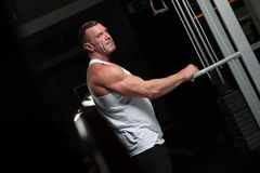 Strong mature man working out in the gym stock photo