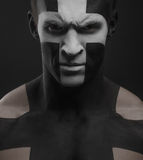 Strong men body art cross white black Royalty Free Stock Images