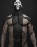 Strong men body art cross white black Royalty Free Stock Image